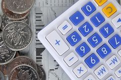 Calculator, coins and stock information Stock Photo
