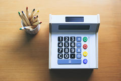 Calculator with color pencils on table Money saving Budget control Royalty Free Stock Images