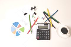 Calculator with colorful pencils and coffee on desk stock photography