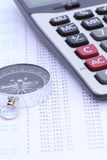 Calculator and compass on bank statement Royalty Free Stock Photography
