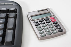 Calculator with a computer keyboard. Close-up of a calculator with a computer keyboard Stock Images
