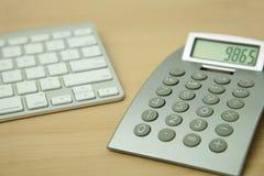 Calculator and Computer Keyboard Stock Photos