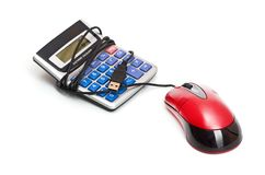 Calculator and computer mouse Royalty Free Stock Image