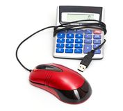 Calculator and computer mouse Stock Photography