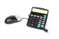 Calculator and computer mouse Royalty Free Stock Images