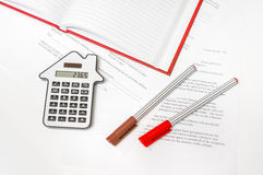 Calculator and contract - insurance, rent and buying car. Calculator and contract on table - insurance, rent, loan and buying car concept royalty free stock photography