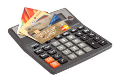 Calculator and credit cards on the white background Royalty Free Stock Photo