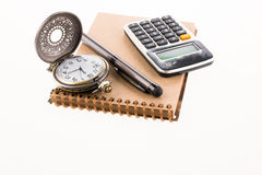Calculator, crumpled paper, pollpoint pen and spiral notebook Royalty Free Stock Image