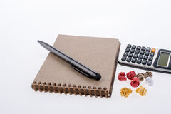 Calculator, crumpled paper, pollpoint pen and spiral notebook Royalty Free Stock Photo