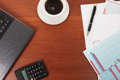 Calculator and cup of coffee on the financial documents Stock Photography