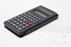 Calculator on design drawing background Royalty Free Stock Photos