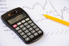Calculator on the desk, pen, calculations. Finance Royalty Free Stock Images