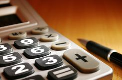 Calculator on a desk and a place Stock Images