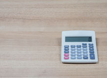 Calculator on the desk Royalty Free Stock Photos