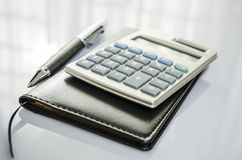 Calculator and diary Stock Photo