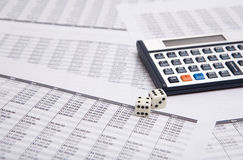Calculator and dice Royalty Free Stock Photography