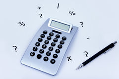 Calculator with different symbols around and a pen on the side. Calculator on a white background with different symbols all around and a pencil on the side stock images