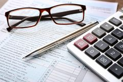 Calculator with documents and glasses on table. Tax concept royalty free stock images