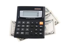 Calculator with dollar bank notes Royalty Free Stock Photography