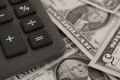 Calculator and dollar banknotes stock photo