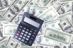 Calculator and dollar banknotes Royalty Free Stock Photo