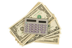 Calculator and dollar bills Stock Photo