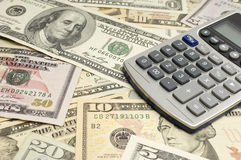 Calculator On Dollar Bills Royalty Free Stock Image