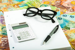 Calculator and dollar bills Stock Images