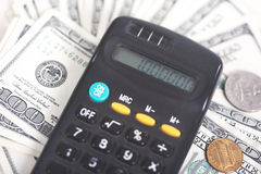 The calculator and dollars Stock Photography