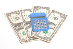 Calculator and dollars. Photograph of a calculator and US dollars,shot in studio against a white background Stock Image