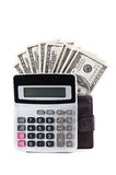 Calculator and dollars. Isolated on a white background Royalty Free Stock Images