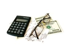 Calculator and dollars Royalty Free Stock Photos