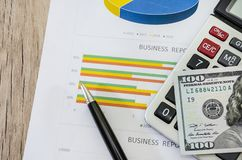 Calculator and 100 dollars on business graph. Close-up stock images