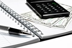 Calculator, dollars and business pen on notebook Royalty Free Stock Photography