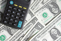 Calculator and dollars royalty free stock images
