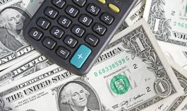 Calculator and dollars Royalty Free Stock Image
