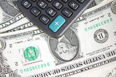Calculator and dollars Stock Image