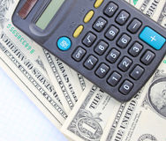 Calculator and dollars Royalty Free Stock Photography