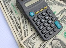 Calculator and dollars Royalty Free Stock Photo