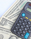 Calculator and dollars stock photography