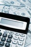 Calculator and dollars Royalty Free Stock Photos