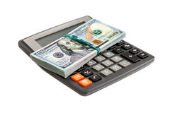 Calculator and dollars over white background Royalty Free Stock Photography