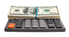 Calculator and dollars on the white background Stock Image