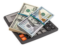 Calculator and dollars on the white background Stock Photos