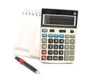 Calculator, een pen, een agenda Royalty-vrije Stock Afbeeldingen