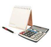 Calculator, een pen, een agenda Stock Foto's