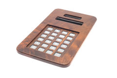 Calculator. Electronic vintage calculator wood cover isolated Stock Images