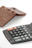 Calculator with empty leather wallet Stock Photo