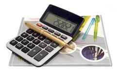 Calculator en boek Stock Fotografie