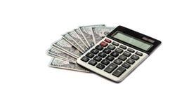 Calculator en dollars op witte achtergrond stock foto
